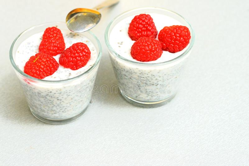 Chia pudding with raspberries royalty free stock photo