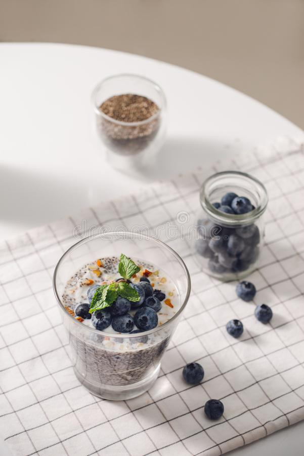 Chia pudding with fresh berries and almond milk. Superfood concept. Vegan, vegetarian and healthy eating diet with organic royalty free stock photography