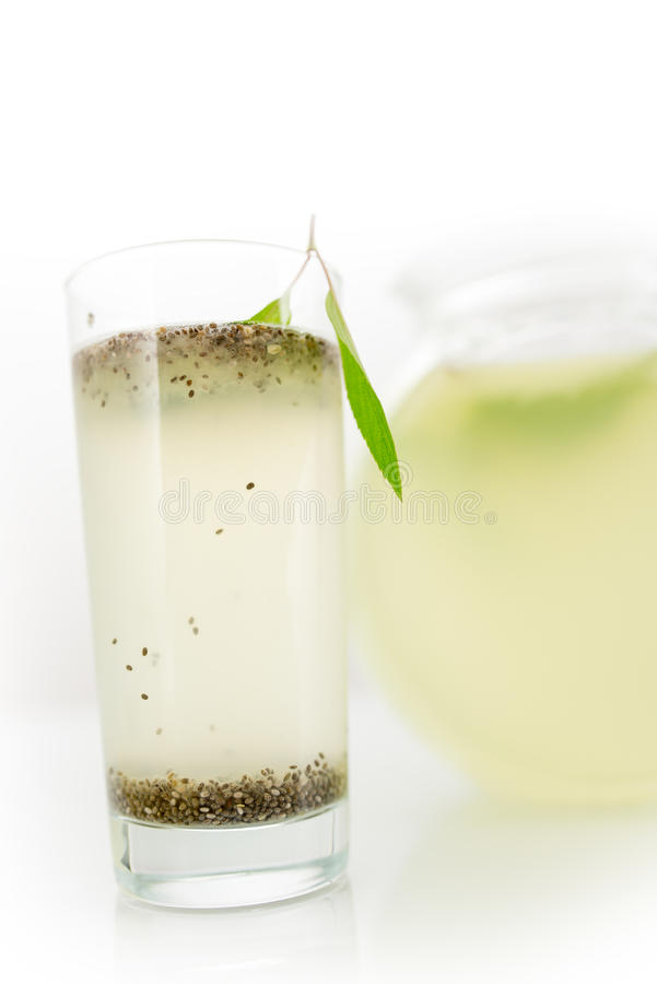 Chia seed lemonade. Tall refreshing glass of healthy chia seed lemonade with the tiny seeds of the Salvia hispanica plant floating on the surface and bottom, a royalty free stock photos