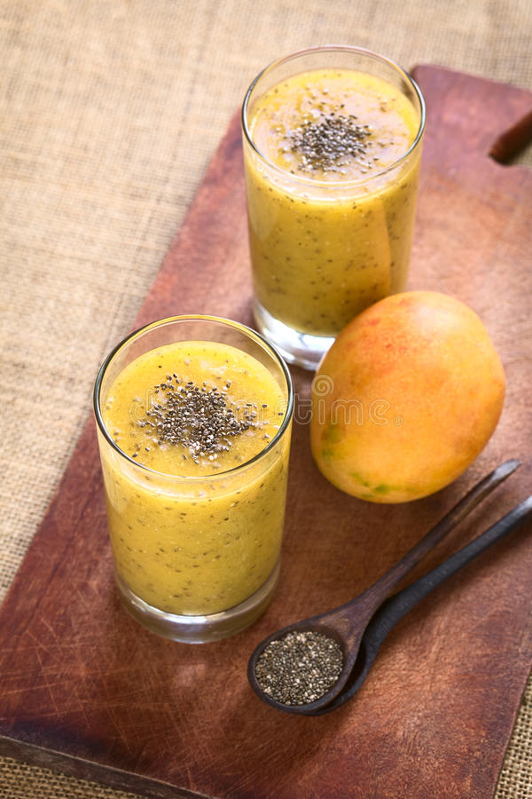 Chia Seed and Mango Juice. Chia seed (lat. Salvia hispanica) and mango juice photographed with natural light. Chia seeds are considered a superfood containing royalty free stock photo