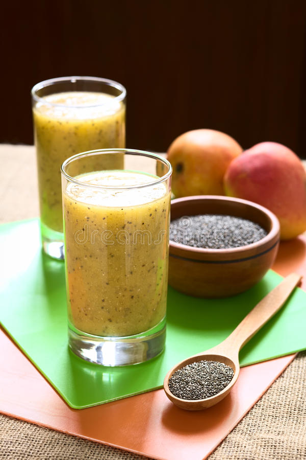 Chia Seed and Mango Juice. Chia seed (lat. Salvia hispanica) and mango juice photographed with natural light. Chia seeds are considered a superfood containing royalty free stock image