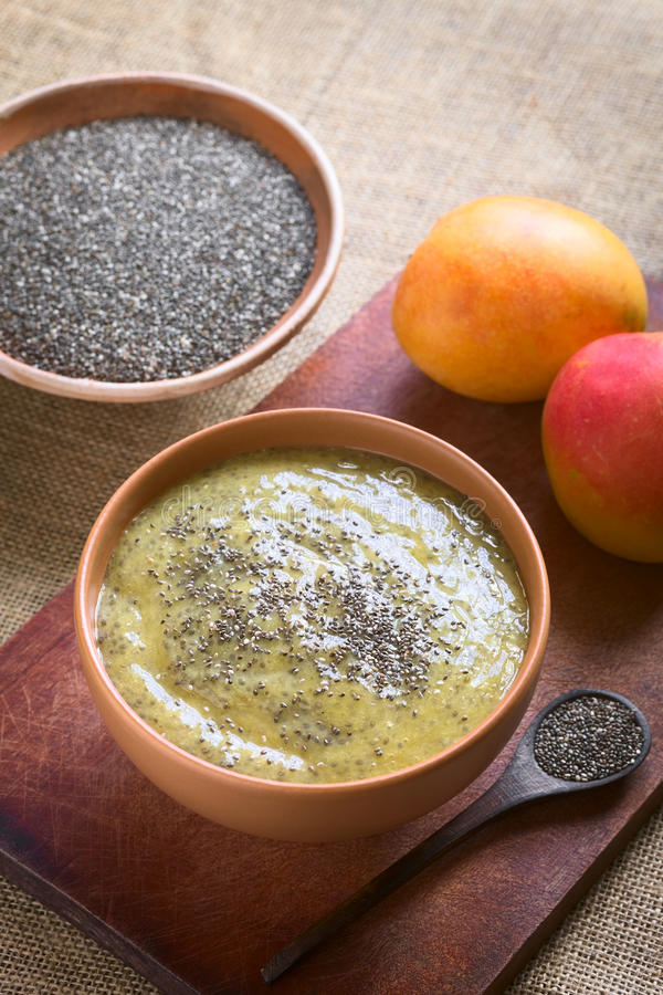 Chia Seed and Mango Pudding. Healthy chia seed (lat. Salvia hispanica) and mango pudding in bowl on wood, photographed with natural light (Selective Focus, Focus stock image