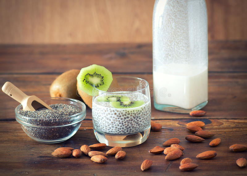 Chia seed pudding. With kiwi and almond milk stock photo