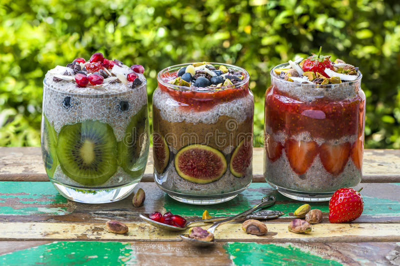 Chia seed pudding. Layered with fruit, almond butter and strawberry sauce royalty free stock photo