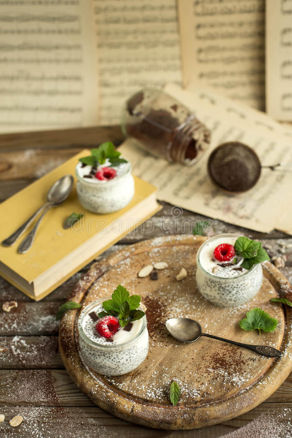 Chia seed pudding with raspberries chocolate and mint in jars. Close up stock images