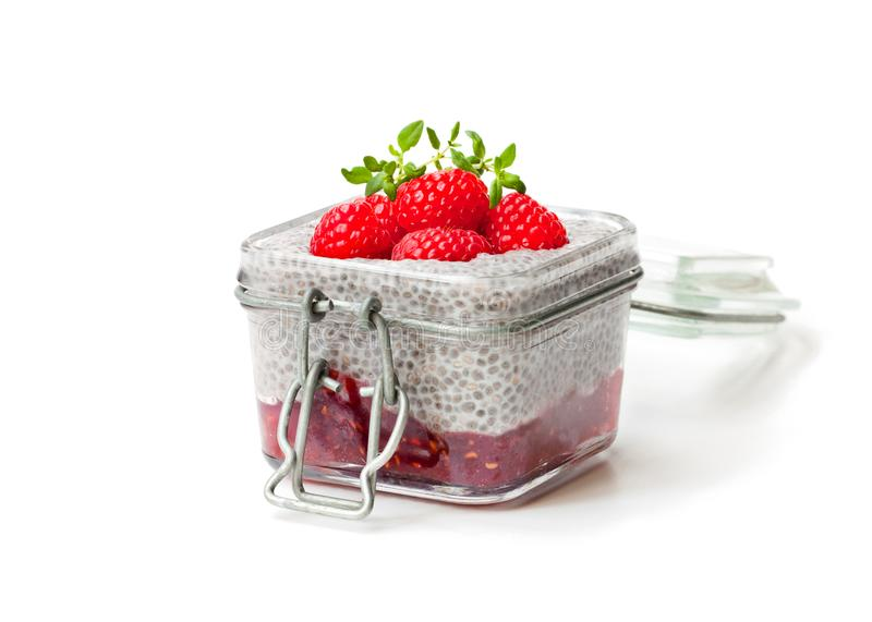 Chia seed pudding with raspberries isolated on white stock image