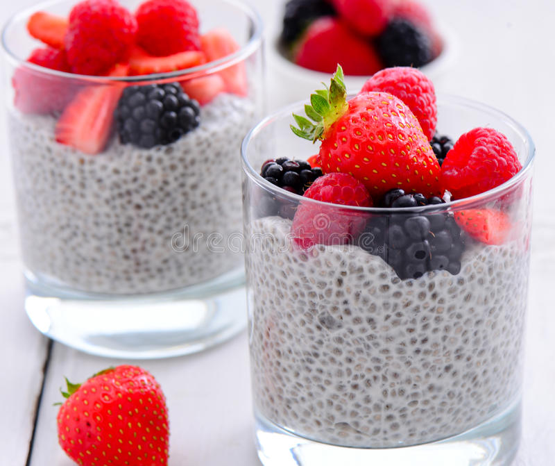Chia seed pudding. Vegan chia seed pudding served with berries soaked in almond milk royalty free stock image