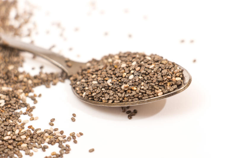 Chia seed on white. Chia seed in a spoon isolated on white background stock image