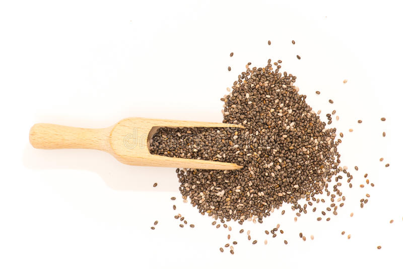 Chia seed on white. Chia seed in a spoon isolated on white background stock photo