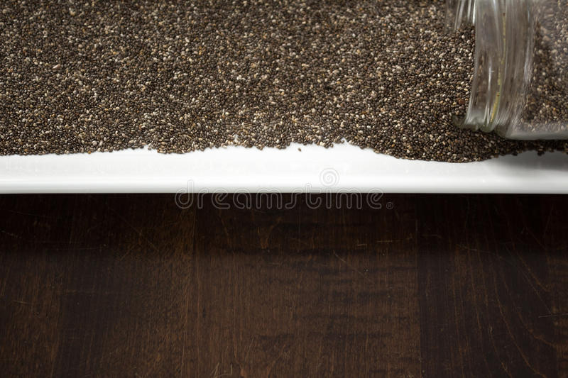 Download Chia Seeds Spilling Out Of Container, Copy Space Stock Photo - Image: 83720492