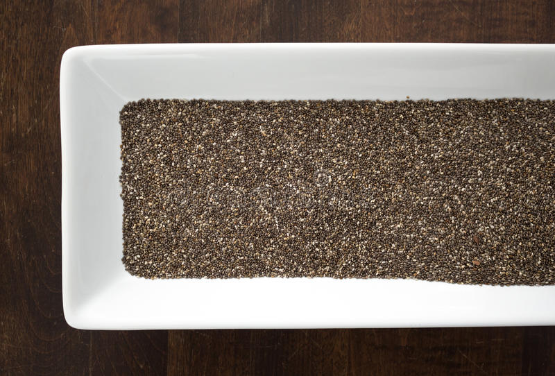 Download Chia Seeds On White Tray On Wood Table Stock Photo - Image: 83721100