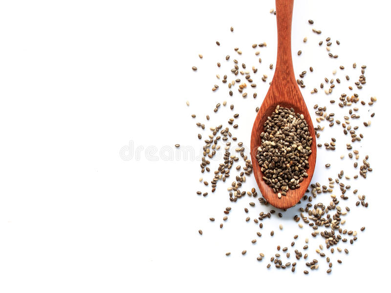 Chia seeds in wood spoon. On a white background stock photos