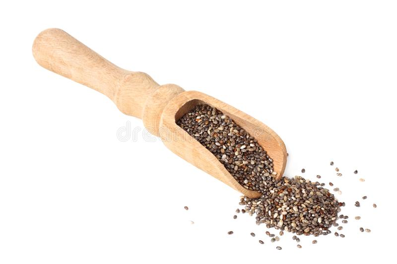 Chia seeds in wooden spoon isolated on white background royalty free stock images