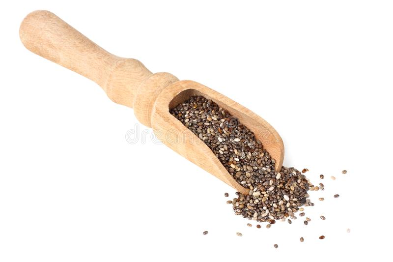 Chia seeds in wooden spoon isolated on white background royalty free stock photography