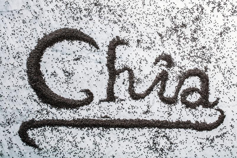Chia word composed from little black chia seeds. royalty free stock image
