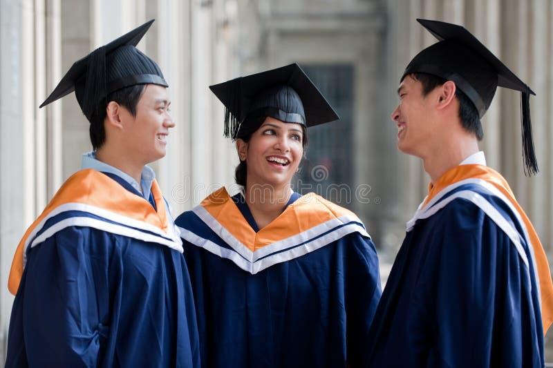 Chiacchierata dei laureati fotografia stock