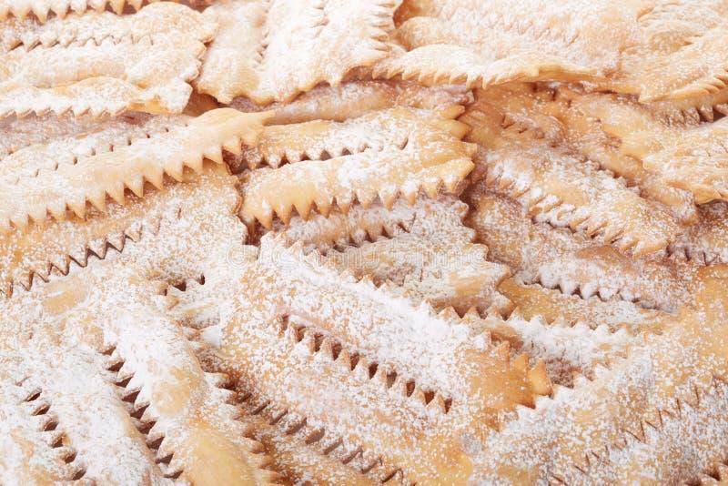 Chiacchiere, włoski ciasta tło fotografia stock
