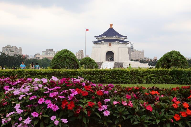 Chiang Kai-Shek Memorial Hall. Blue and white Chiang Kai-Shek Memorial Hall and beautiful pink and red flowers. Taipei, Taiwan stock photo