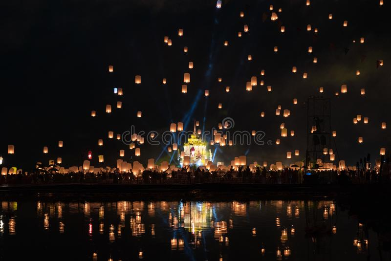 Chiang Mai lantern festival with lantern flying on the sky and crowd of people who is going to release the lanterns.  stock photo