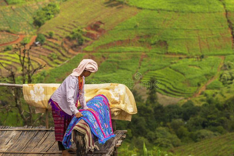 Chiang Mai , Thailand , August 11 , 2019 :Karen woman Clean the house on the top of the hill stock photography