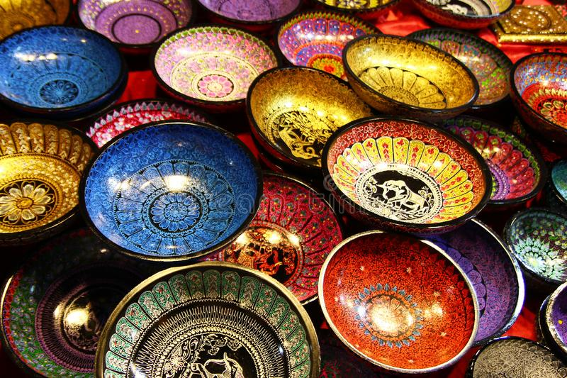 Chiang Mai, Thailand - December 2, 2017: Painted colorful wooden plates with traditional Thai design. stock photography