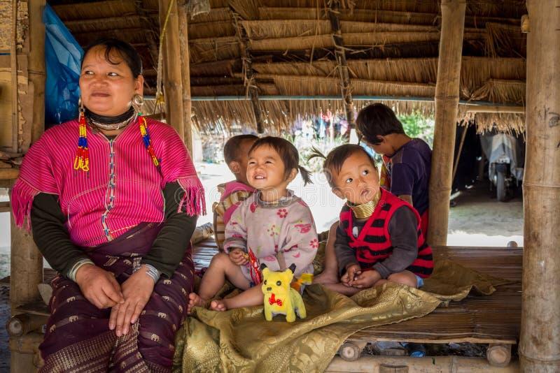 Long neck family in 'Long Neck Karen' ethnic hill-tribe village. Chiang Mai, Thailand - February 02, 2018: Long neck family in 'Long Neck stock images