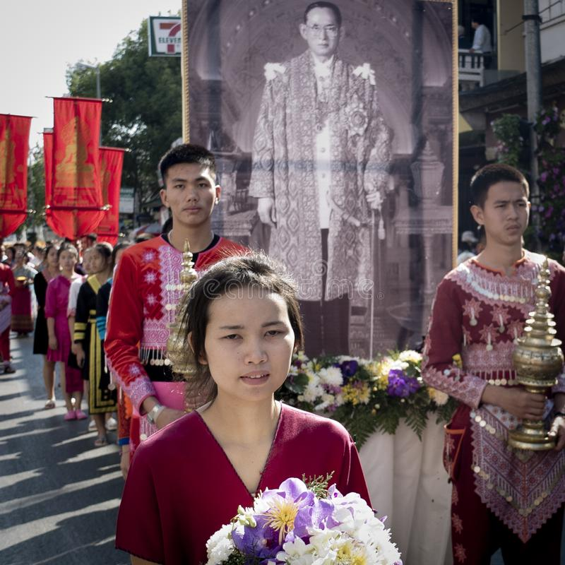 Solemn young thai people with a King Bhumibol banner stock images