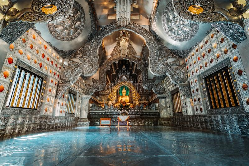 Chiang Mai, Thailand, 12.16.18: Inside the silver temple. Wide angle shot of the scenery. Gold and silver ornaments at the walls. Beautiful handwork. Buddha royalty free stock image