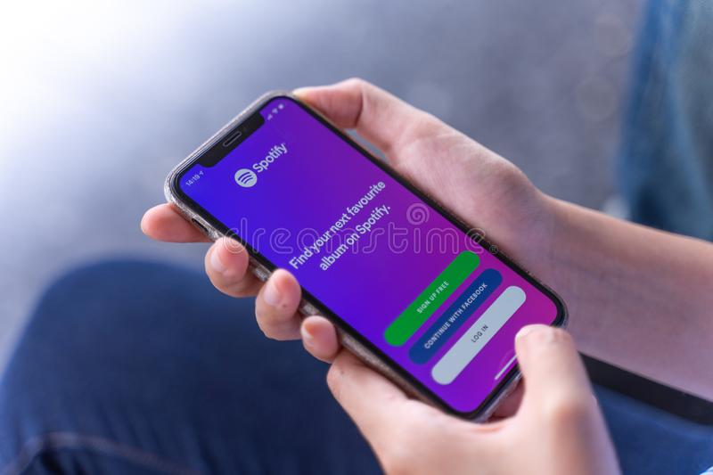 CHIANG MAI ,THAILAND JUN 23 2019 : Apple iPhone Xs smartphone with Spotify app on screen. royalty free stock photo