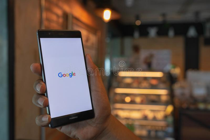 CHIANG MAI, THAILAND - June 09,2018: Man hands holding HUAWEI with google search on screen. Google is the biggest Internet search. Engine and online advertising royalty free stock images