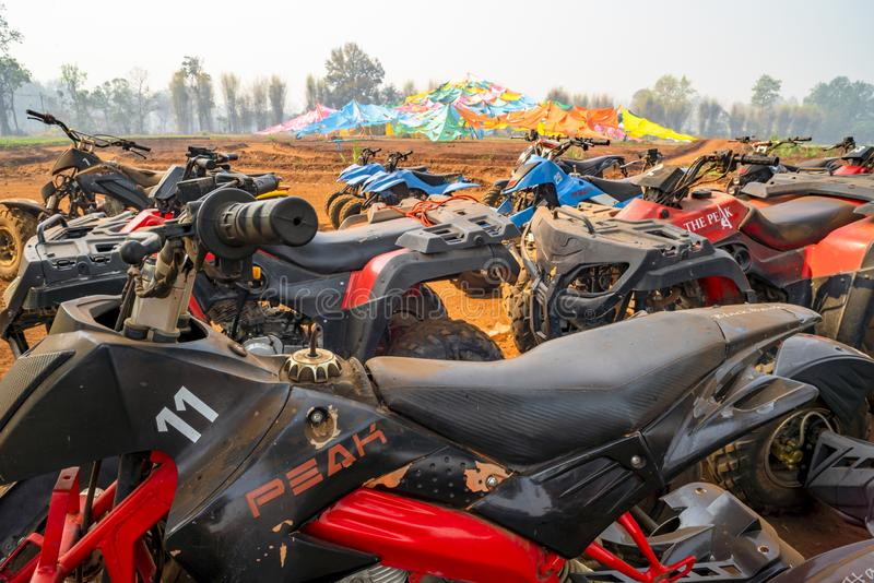 Chiang Mai/Thailand - March 14, 2019: A fleet of ATV quad bikes parking after the racing finished. royalty free stock photo