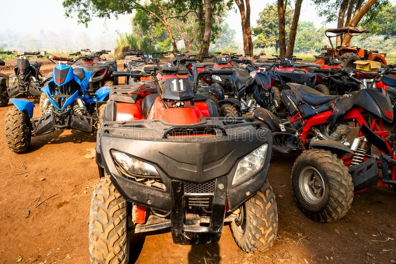 Chiang Mai/Thailand - March 14, 2019: A fleet of ATV quad bikes parking after the racing finished. royalty free stock photos