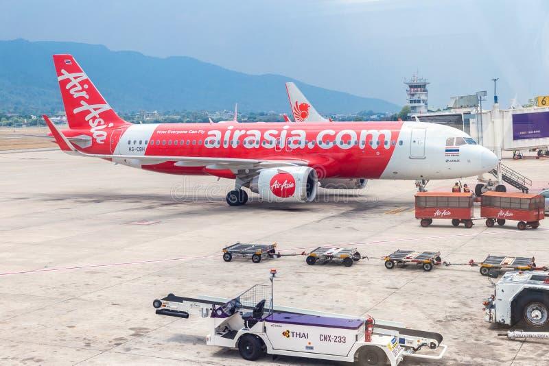 AirAsia aircraft at Chiang Mai International Airport in Chiang Mai, THAILAND. Chiang Mai, THAILAND - May 7, 2019 : AirAsia aircraft at Chiang Mai International stock image