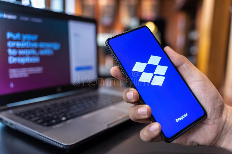 CHIANG MAI, THAILAND - May.01,2019: Man holding Xiaomi Mi Mix 3 with Dropbox on screen.Dropbox is a service that gives you access. To images, documents and stock photography