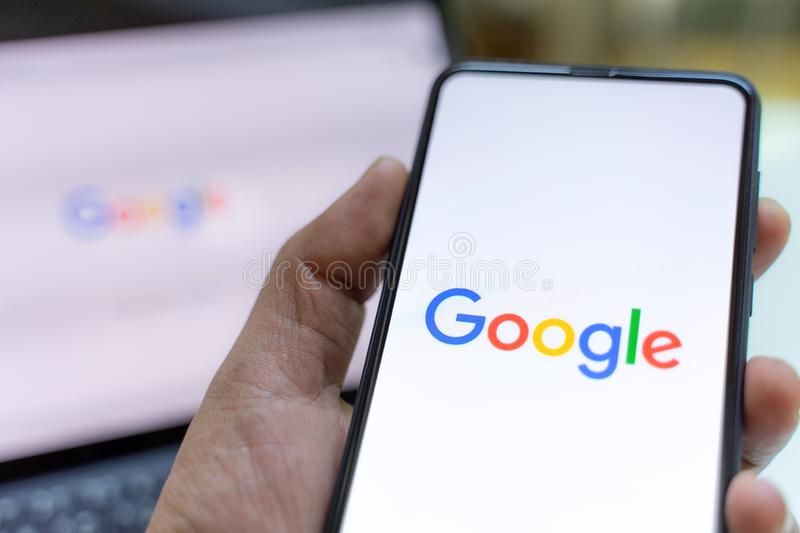CHIANG MAI, THAILAND - May.26,2019: Man holding Xiaomi Mi Mix 3 with google search on screen. royalty free stock photography