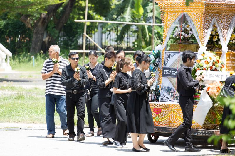 CHIANG MAI, THAILAND - MAY 19: Unidentified sad people in black cloths walking around the wooden palace of the dead body Thai stock photos