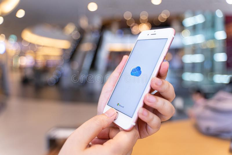 CHIANG MAI, THAILAND - May.10,2019: Woman holding Apple iPhone 6S Rose Gold with OneDrive on screen. Microsoft OneDrive is a file hosting service that allows stock photos