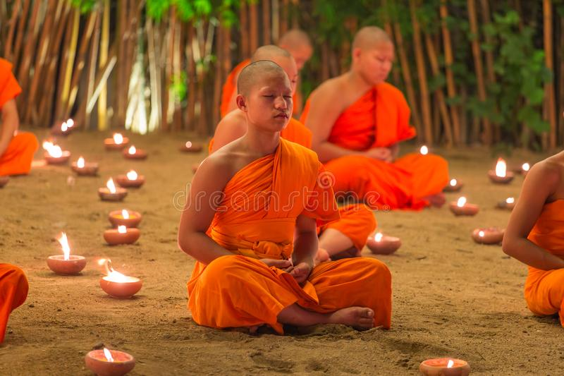 Loy Kratong Festival, Buddhist monk fire candles to the Buddha and floating lamp on in Phan Tao Temple, Chiangmai, Thailand. Chiang Mai, Thailand - November 14 stock images