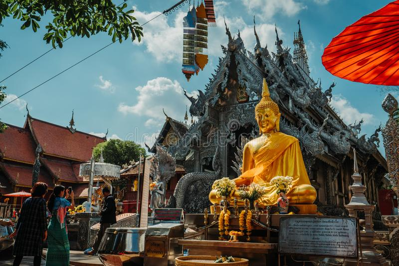 Chiang Mai, Thailand, 12.16.18: Outside the silver temple. Wide angle shot of the scenery. Gold and silver ornaments at the walls stock photo