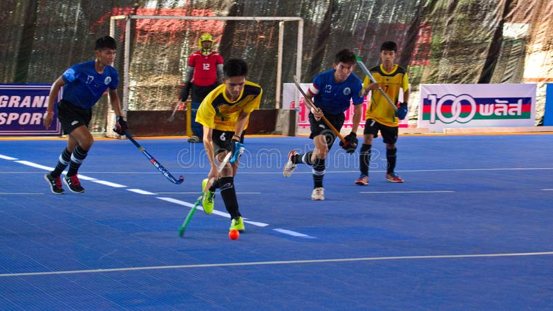 Hockey player in action during the Thailand National Games, Chiang Rai Games. Chiang Rai, Thailand – November 18, 2018 : Hockey player in action during royalty free stock photo
