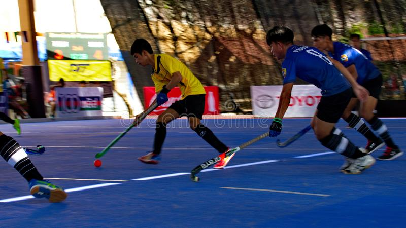 Hockey player in action during the Thailand National Games, Chiang Rai Games. Chiang Rai, Thailand – November 18, 2018 : Hockey player in action during stock images