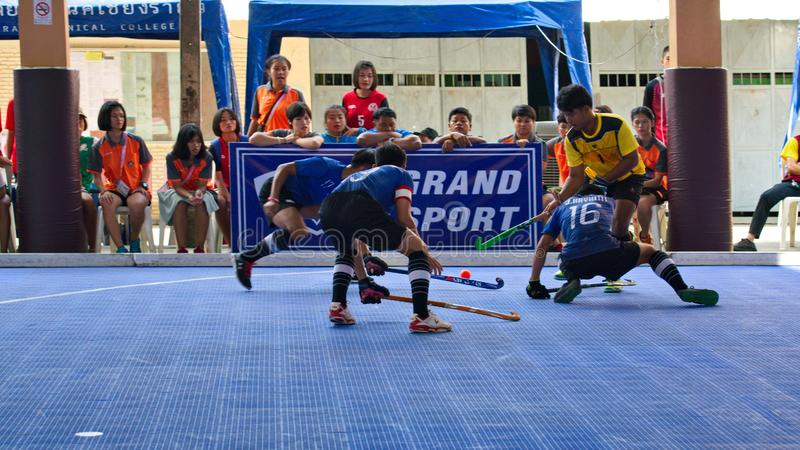 Hockey player in action during the Thailand National Games, Chiang Rai Games. Chiang Rai, Thailand – November 18, 2018 : Hockey player in action during royalty free stock photography