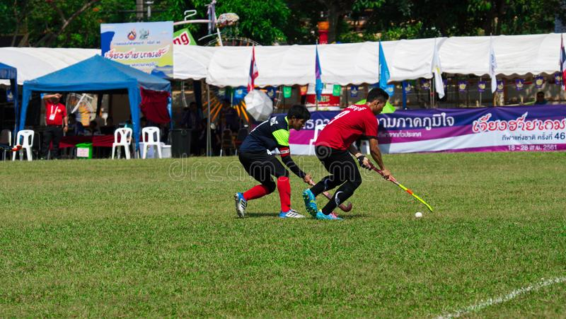 Outdoor Hockey. Hockey player in action during the Thailand National Games. Chiang Rai, Thailand – November 18, 2018 : Hockey player in action during the royalty free stock photo