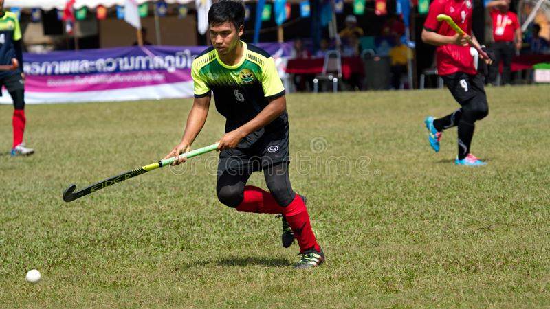 Outdoor Hockey. Hockey player in action during the Thailand National Games. Chiang Rai, Thailand – November 18, 2018 : Hockey player in action during the stock photo