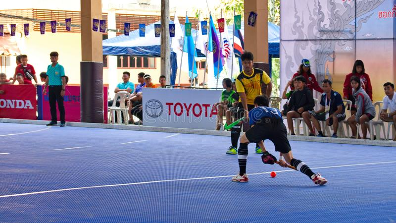 Indoor Hockey. Hockey player in action during the Thailand National Games, Chiang Rai Games. Chiang Rai, Thailand – November 18, 2018 : Hockey player in stock photography