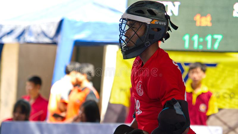 Indoor Hockey. Goalkeeper in action during the Thailand National Games, Chiang Rai Games. Chiang Rai, Thailand – November 18, 2018 : Hockey player in stock photo
