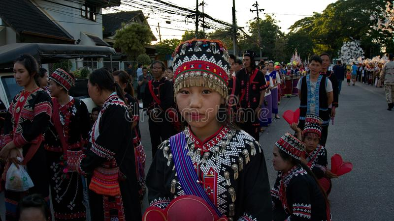 China`s Yunnan people in the parade for promoted 46th Thailand National Games. Chiang Rai, Thailand – October 28, 2018 : Traditional Parade for promoted royalty free stock images