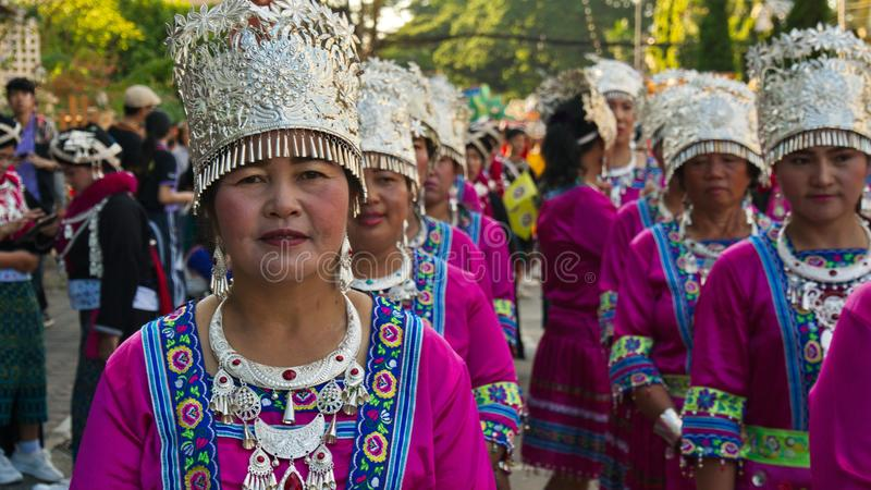 China`s Yunnan people in the parade for promoted 46th Thailand National Games. Chiang Rai, Thailand – October 28, 2018 : Traditional Parade for promoted stock photos