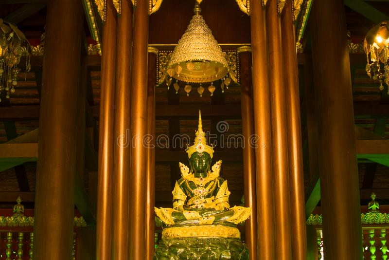 A copy of an ancient statue of the Emerald Buddha in a Buddhist temple royalty free stock photography