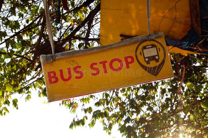 Chiang Rai, Thailand - December 17, 2017: Inscription and sign 'Bus stop' on a yellow banner. stock image